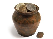 Jug of Old Coins Royalty Free Stock Images