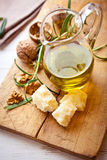 Jug of olive oil, Grana Padano cheese and walnuts Stock Photography