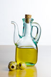 Jug of Olive Oil with Olives Stock Image