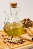 Jug of Olive Oil with Olives. Royalty Free Stock Photos