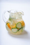 Jug with orange cucumber refreshing drink, rustic style, selective focus Royalty Free Stock Images