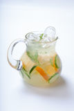 Jug with orange cucumber refreshing drink, rustic style, selective focus Royalty Free Stock Photography