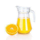 Jug of orange juice and citrus fruits