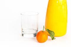 Jug of orange juice, glass and an orange Stock Images