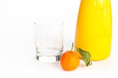 Jug of orange juice, glass and an orange. Jug of freshly squeezed orange juice, empty glass and orange fruit on isolating background stock images