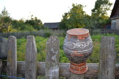 The jug over the fence Royalty Free Stock Images
