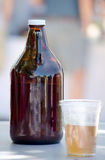 Jug and plastic cup of beer Royalty Free Stock Photo