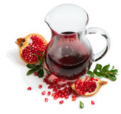 Jug of pomegranate juice Stock Images
