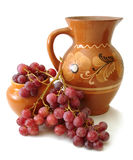 Jug and red grapes Stock Images