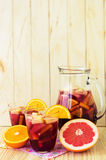 A jug of refreshing sangria with fruits Stock Photography