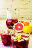 A jug of refreshing sangria with fruits on wooden background Stock Photography