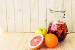 A jug of refreshing sangria with fruits on wooden background Royalty Free Stock Photo