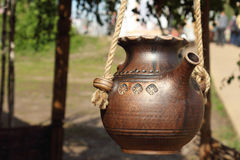 Jug on a rope Royalty Free Stock Photos