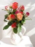 Jug of roses. royalty free stock photo