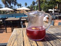 Jug of sangria. At the pool side cafe Royalty Free Stock Image