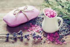 Jug of sea salt, bar of homemade soap and dry lavender flowers. Royalty Free Stock Image