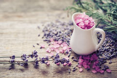 Jug of sea salt  and dry lavender flowers. Stock Image