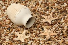 Jug and starfishes Stock Photos
