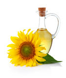 Jug sunflower oil with flower isolated on white Stock Photos