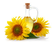Jug of sunflower oil with flowers isolated stock photos