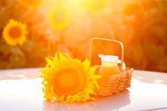 Jug with sunflower oil in wicker basket Stock Photo