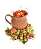 Jug with a sweet cherry among berries Stock Photos