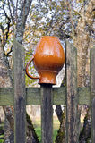 Jug on the village fence Royalty Free Stock Image