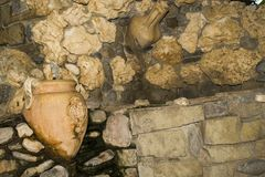 From the jug water runs up. Royalty Free Stock Photography