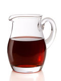 Jug of wine. A jug filled with red wine isolated on a white background Royalty Free Stock Photo