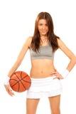 Jugador atractivo de la mujer joven de la aptitud del baloncesto Foto de archivo