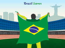 Jugador con la bandera brasileña para el concepto de los deportes Foto de archivo