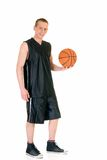 Jugador de básquet de sexo masculino joven imagen de archivo