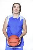 Jugador de básquet del adolescente sobre un fondo blanco Imagen de archivo