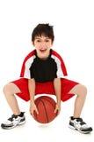 Jugador de básquet divertido torpe del niño del muchacho Imágenes de archivo libres de regalías