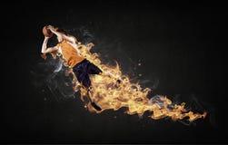 Jugador de básquet en el fuego fotografía de archivo
