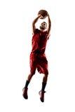 Jugador de básquet en la acción aislado en blanco Foto de archivo