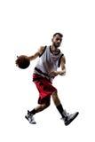 Jugador de básquet en la acción aislado en blanco Imagen de archivo libre de regalías