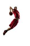 Jugador de básquet en la acción aislado en blanco Fotografía de archivo libre de regalías