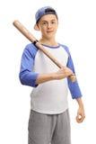 Jugador de béisbol adolescente con un palo que mira la cámara Fotos de archivo