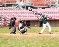 Jugador de béisbol en el palo. Imagenes de archivo