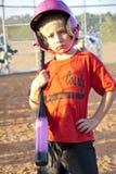 Jugador de beísbol con pelota blanda/chica joven Fotografía de archivo