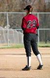Jugador de beísbol con pelota blanda femenino Imagen de archivo