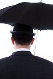 Jugador de bolos y paraguas Fotos de archivo libres de regalías