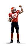 Jugador de fútbol americano en blanco de la acción aislado Imagen de archivo libre de regalías