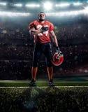 Jugador de fútbol americano en la acción Imágenes de archivo libres de regalías