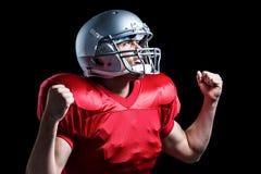 Jugador de fútbol americano que anima con el puño apretado fotografía de archivo libre de regalías