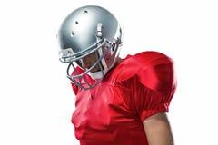 Jugador de fútbol americano que mira abajo Imagen de archivo libre de regalías