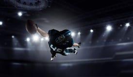 Jugador de fútbol americano Técnicas mixtas foto de archivo