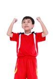 Jugador de fútbol asiático que muestra el brazo encima del gesto Acción del ganador o Foto de archivo libre de regalías