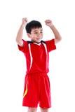 Jugador de fútbol asiático que muestra el brazo encima del gesto Acción del ganador o Foto de archivo